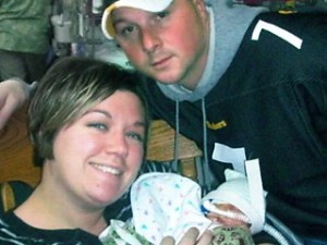 Katie and Craig Van Tornhout with their newborn daughter Callie