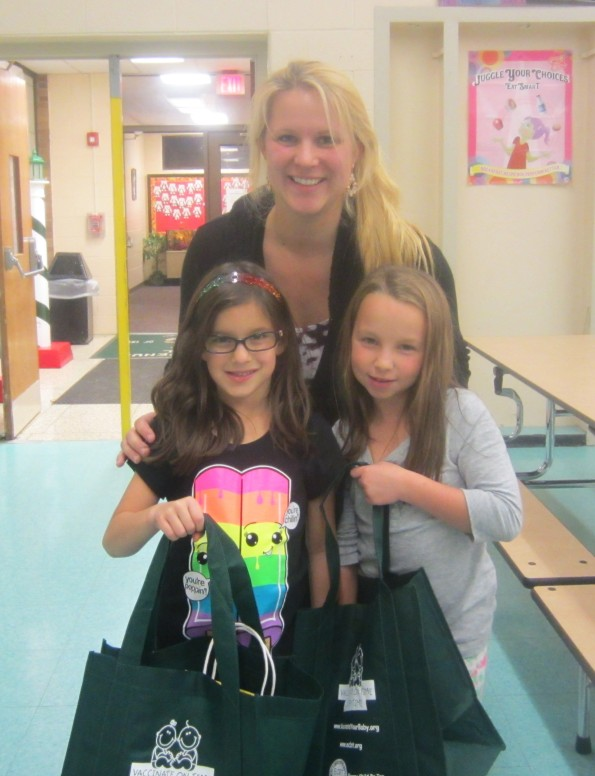 Melody Butler is pictured with two of the Kick the Flu Out of School contest participants.